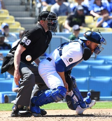 Mar 31, 2019; Los Angeles, CA, USA; A pitch in the dirt gets past Los Angeles Dodgers catcher Russell Martin (55) allowing a run to score in the fourth inning against the Arizona Diamondbacks at Dodger Stadium. Mandatory Credit: Jayne Kamin-Oncea-USA TODAY Sports