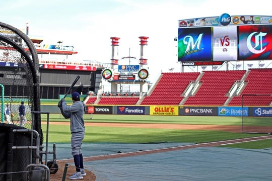 Apr 1, 2019; Cincinnati, OH, USA; Milwaukee Brewers right fielder Christian Yelich (22) takes batting practice prior to the game against the Cincinnati Reds Great American Ball Park. Mandatory Credit: Aaron Doster-USA TODAY Sports