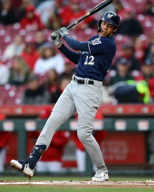 Apr 1, 2019; Cincinnati, OH, USA; Milwaukee Brewers right fielder Christian Yelich (22) reacts to striking out at bat against the Cincinnati Reds in the first inning at Great American Ball Park. Mandatory Credit: Aaron Doster-USA TODAY Sports