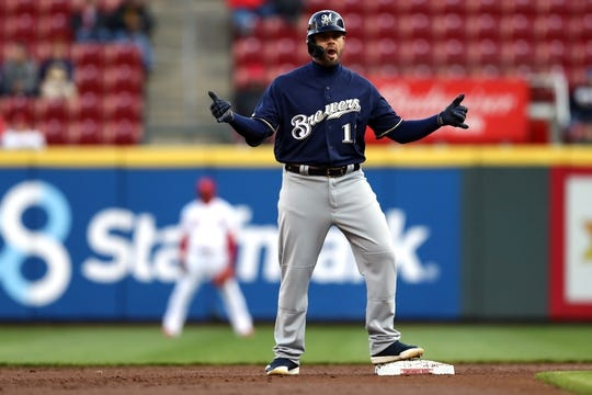 Apr 1, 2019; Cincinnati, OH, USA; Milwaukee Brewers second baseman Mike Moustakas (11) reacts to hitting an RBI double against the Cincinnati Reds in the first inning at Great American Ball Park. Mandatory Credit: Aaron Doster-USA TODAY Sports