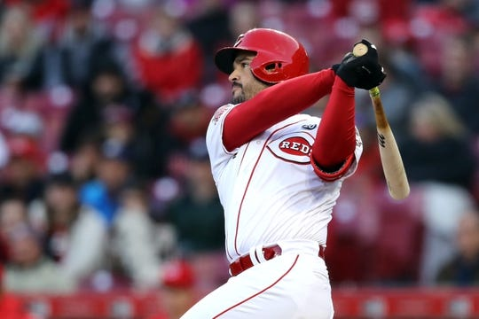 Apr 1, 2019; Cincinnati, OH, USA; Cincinnati Reds third baseman Eugenio Suarez (7) singles against the Milwaukee Brewers in the first inning at Great American Ball Park. Mandatory Credit: Aaron Doster-USA TODAY Sports