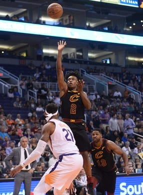 Apr 1, 2019; Phoenix, AZ, USA; Cleveland Cavaliers guard Collin Sexton (2) shoots over Phoenix Suns forward Richaun Holmes (21) during the first half at Talking Stick Resort Arena. Mandatory Credit: Joe Camporeale-USA TODAY Sports