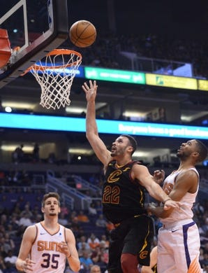 Apr 1, 2019; Phoenix, AZ, USA; Cleveland Cavaliers forward Larry Nance Jr. (22) puts up a layup against the Phoenix Suns during the first half at Talking Stick Resort Arena. Mandatory Credit: Joe Camporeale-USA TODAY Sports