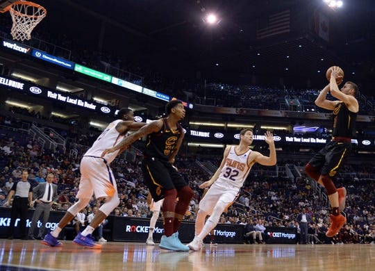 Apr 1, 2019; Phoenix, AZ, USA; Cleveland Cavaliers guard Nik Stauskas (1) shoots against the Phoenix Suns during the first half at Talking Stick Resort Arena. Mandatory Credit: Joe Camporeale-USA TODAY Sports