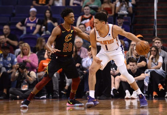 Apr 1, 2019; Phoenix, AZ, USA; Phoenix Suns guard Devin Booker (1) dribbles against Cleveland Cavaliers guard Brandon Knight (20) during the first half at Talking Stick Resort Arena. Mandatory Credit: Joe Camporeale-USA TODAY Sports