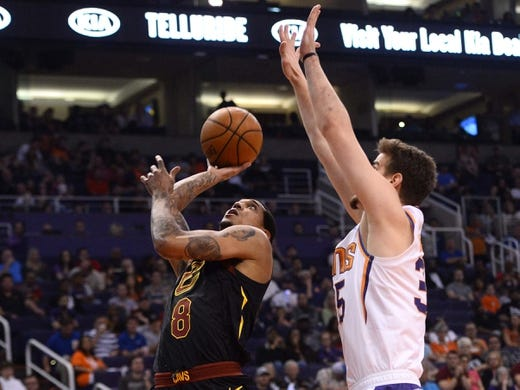 Apr 1, 2019; Phoenix, AZ, USA; Cleveland Cavaliers guard Jordan Clarkson (8) goes up for a layup over Phoenix Suns forward Dragan Bender (35) during the first half at Talking Stick Resort Arena. Mandatory Credit: Joe Camporeale-USA TODAY Sports