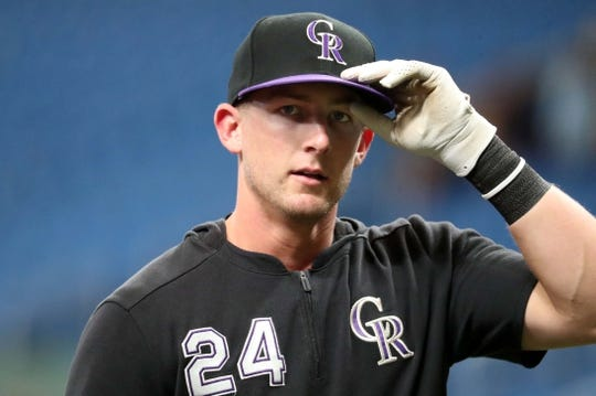 Apr 2, 2019; St. Petersburg, FL, USA; Colorado Rockies first baseman Ryan McMahon (24) works out prior to the game against the Tampa Bay Rays at Tropicana Field. Mandatory Credit: Kim Klement-USA TODAY Sports
