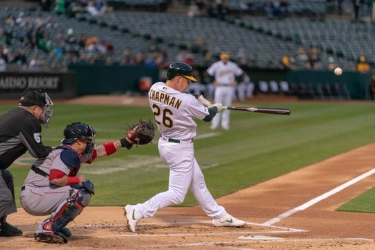 Apr 2, 2019; Oakland, CA, USA; Oakland Athletics third baseman Matt Chapman (26) hits a home run during the first inning against the Boston Red Sox at Oakland Coliseum. Mandatory Credit: Neville E. Guard-USA TODAY Sports