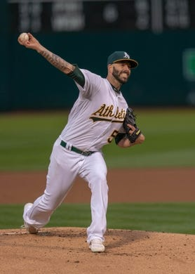 Apr 2, 2019; Oakland, CA, USA; Oakland Athletics starting pitcher Mike Fiers (50) delivers a pitch during the first inning against the Boston Red Sox at Oakland Coliseum. Mandatory Credit: Neville E. Guard-USA TODAY Sports