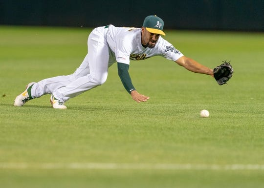 Apr 2, 2019; Oakland, CA, USA; Oakland Athletics shortstop Marcus Semien (10) attempt to field a ground ball during the fourth inning against the Boston Red Sox at Oakland Coliseum. Mandatory Credit: Neville E. Guard-USA TODAY Sports