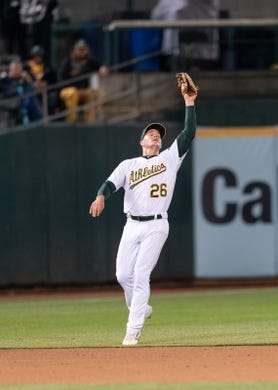 Apr 2, 2019; Oakland, CA, USA; Oakland Athletics third baseman Matt Chapman (26) fields a fly ball during the sixth inning against the Boston Red Sox at Oakland Coliseum. Mandatory Credit: Neville E. Guard-USA TODAY Sports