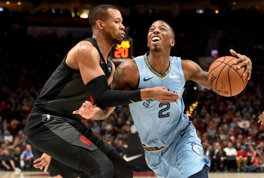 Apr 3, 2019; Portland, OR, USA; Memphis Grizzlies guard Delon Wright (2) drives to the basket on Portland Trail Blazers guard Rodney Hood (5) during the first half of the game at the Moda Center. Mandatory Credit: Steve Dykes-USA TODAY Sports