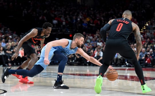 Apr 3, 2019; Portland, OR, USA; Memphis Grizzlies forward Chandler Parsons (25) goes after a loose ball in front of forward Al-Farouq Aminu (8) during the first half of the game at the Moda Center. Mandatory Credit: Steve Dykes-USA TODAY Sports