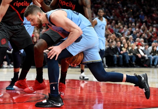 Apr 3, 2019; Portland, OR, USA; Memphis Grizzlies forward Chandler Parsons (25) tries to control the ball during the first half of the game against the Portland Trail Blazers at the Moda Center. Mandatory Credit: Steve Dykes-USA TODAY Sports