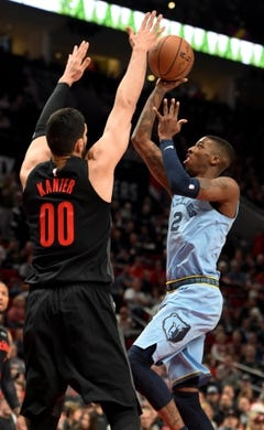 Apr 3, 2019; Portland, OR, USA; Memphis Grizzlies guard Delon Wright (2) drives to the basket on Portland Trail Blazers center Enes Kanter (00) during the first half of the game at the Moda Center. Mandatory Credit: Steve Dykes-USA TODAY Sports