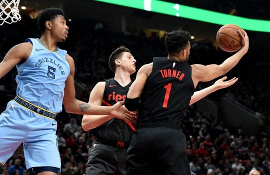 Apr 3, 2019; Portland, OR, USA; Portland Trail Blazers guard Evan Turner (1) and forward Zach Collins (33) go after a rebound as Memphis Grizzlies forward Bruno Caboclo (5) looks on during the first half of the game at the Moda Center. Mandatory Credit: Steve Dykes-USA TODAY Sports