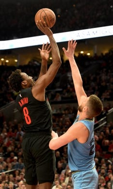 Apr 3, 2019; Portland, OR, USA; Portland Trail Blazers forward Al-Farouq Aminu (8) hits a shot over Memphis Grizzlies forward Chandler Parsons (25) during the second half of the game at the Moda Center. The Blazers won 116-89. Mandatory Credit: Steve Dykes-USA TODAY Sports