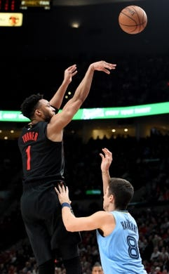 Apr 3, 2019; Portland, OR, USA; Portland Trail Blazers guard Evan Turner (1) hits a shot over Memphis Grizzlies guard Dusty Hannahs (8) during the second half of the game at the Moda Center. The Blazers won 116-89. Mandatory Credit: Steve Dykes-USA TODAY Sports