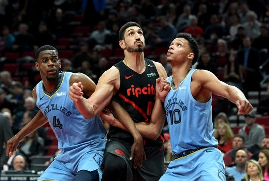 Apr 3, 2019; Portland, OR, USA; Portland Trail Blazers center Enes Kanter (00), center, battles for a position with Memphis Grizzlies forward Julian Washburn (4), left, and forward Ivan Rabb (10), right, during the second half of the game at the Moda Center. The Blazers won 116-89. Mandatory Credit: Steve Dykes-USA TODAY Sports