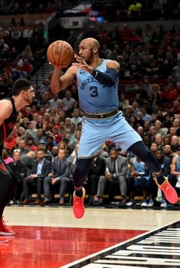 Apr 3, 2019; Portland, OR, USA; Memphis Grizzlies guard Jevon Carter (3) grabs a ball before it goes out of bounds in front of Portland Trail Blazers center Enes Kanter (00) during the second half of the game at the Moda Center. The Blazers won 116-89. Mandatory Credit: Steve Dykes-USA TODAY Sports