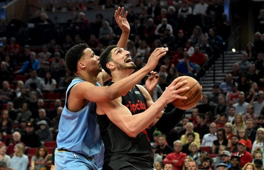 Apr 3, 2019; Portland, OR, USA; Portland Trail Blazers center Enes Kanter (00) goes up for a shot on Memphis Grizzlies forward Ivan Rabb (10) during the second half of the game at the Moda Center. The Blazers won 116-89. Mandatory Credit: Steve Dykes-USA TODAY Sports