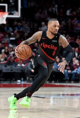 Apr 3, 2019; Portland, OR, USA; Portland Trail Blazers guard Damian Lillard (0) drives to the basket during the second half of the game against the Memphis Grizzlies at the Moda Center. The Blazers won 116-89. Mandatory Credit: Steve Dykes-USA TODAY Sports
