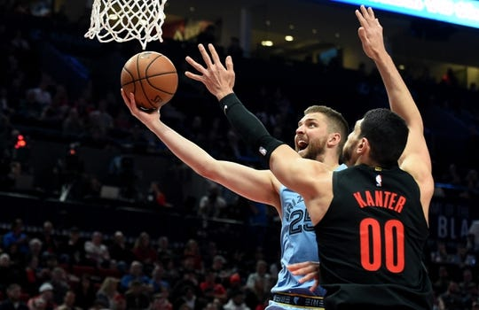 Apr 3, 2019; Portland, OR, USA; Memphis Grizzlies forward Chandler Parsons (25) drives to the basket on Portland Trail Blazers center Enes Kanter (00) during the first half of the game at the Moda Center. The Blazers won 116-89.Mandatory Credit: Steve Dykes-USA TODAY Sports