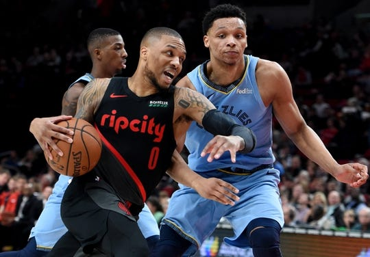 Apr 3, 2019; Portland, OR, USA; Portland Trail Blazers guard Damian Lillard (0) drives to the basket on Memphis Grizzlies forward Ivan Rabb (10) during the second half of the game at the Moda Center. The Blazers won 116-89. Mandatory Credit: Steve Dykes-USA TODAY Sports