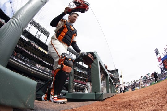 Apr 6, 2019; San Francisco, CA, USA; San Francisco Giants catcher Buster Posey (28) walks onto the field prior to the game against the Tampa Bay Rays at Oracle Park. Mandatory Credit: D. Ross Cameron-USA TODAY Sports