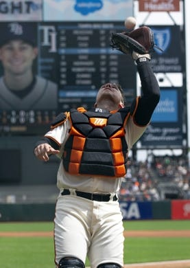 Apr 6, 2019; San Francisco, CA, USA; San Francisco Giants catcher Buster Posey (28) makes the catch of a foul popup by Tampa Bay Rays Brandon Lowe during the first inning of a game at Oracle Park. Mandatory Credit: D. Ross Cameron-USA TODAY Sports