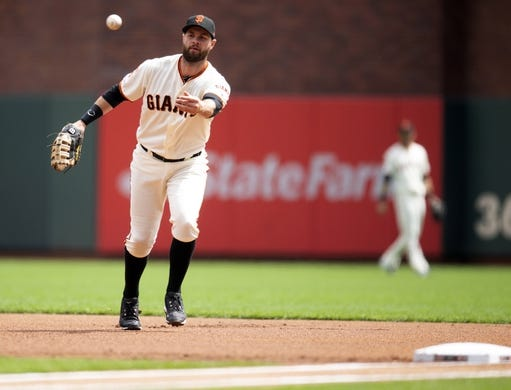 Apr 6, 2019; San Francisco, CA, USA; San Francisco Giants first baseman Brandon Belt (9) flips the ball to the pitcher covering on a ground ball by Tampa Bay Rays Austin Meadows (not pictured) during the first inning of a game at Oracle Park. Mandatory Credit: D. Ross Cameron-USA TODAY Sports