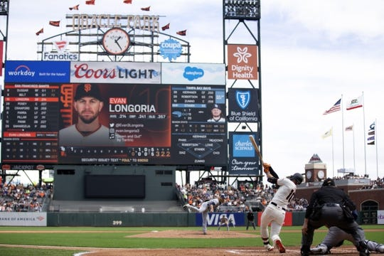 Apr 6, 2019; San Francisco, CA, USA; San Francisco Giants Evan Longoria (10) swings and misses for the third out during the first inning of a game against the Tampa Bay Rays at Oracle Park. Mandatory Credit: D. Ross Cameron-USA TODAY Sports