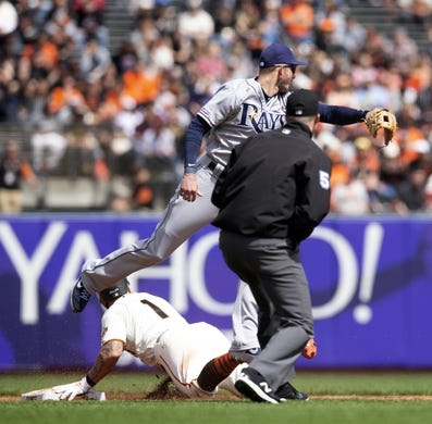 Apr 6, 2019; San Francisco, CA, USA; Tampa Bay Rays shortstop Daniel Robertson (28) leaps in vain for an errant throw from catcher as San Francisco Giants Kevin Pillar (1) steals second base during the third inning of a game at Oracle Park. Pillar moved to third on the error. Umpire is Nic Lentz. Mandatory Credit: D. Ross Cameron-USA TODAY Sports
