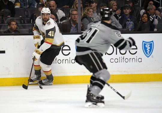 April 6, 2019; Los Angeles, CA, USA; Vegas Golden Knights center Pierre-Edouard Bellemare (41) moves the puck against Los Angeles Kings defenseman Matt Roy (81) during the first period at Staples Center. Mandatory Credit: Gary A. Vasquez-USA TODAY Sports