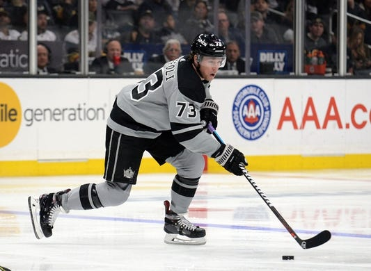 April 6, 2019; Los Angeles, CA, USA; Los Angeles Kings right wing Tyler Toffoli (73) moves the puck against the Vegas Golden Knights during the second period at Staples Center. Mandatory Credit: Gary A. Vasquez-USA TODAY Sports