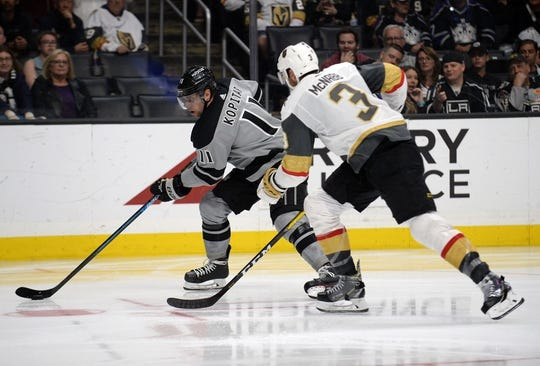 April 6, 2019; Los Angeles, CA, USA; Los Angeles Kings center Anze Kopitar (11) moves the puck against Vegas Golden Knights defenseman Brayden McNabb (3) during the second period at Staples Center. Mandatory Credit: Gary A. Vasquez-USA TODAY Sports