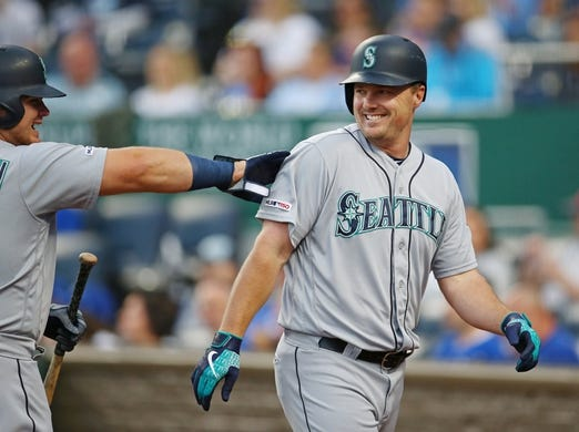 Apr 9, 2019; Kansas City, MO, USA; Seattle Mariners right fielder Jay Bruce (32) is congratulated by designated hitter Daniel Vogelbach  (20) after hitting a home run against the Kansas City Royals in the first inning at Kauffman Stadium. Mandatory Credit: Jay Biggerstaff-USA TODAY Sports