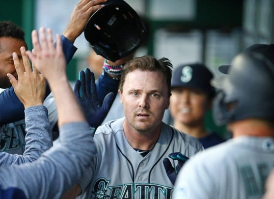 Apr 9, 2019; Kansas City, MO, USA; Seattle Mariners right fielder Jay Bruce (32) is congratulated after hitting a home run against the Kansas City Royals in the first inning at Kauffman Stadium. Mandatory Credit: Jay Biggerstaff-USA TODAY Sports