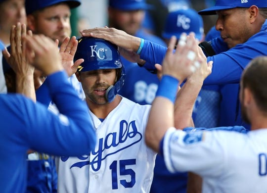 Apr 9, 2019; Kansas City, MO, USA; Kansas City Royals right fielder Whit Merrifield (15) is congratulated after scoring against the Seattle Mariners in the first inning at Kauffman Stadium. Mandatory Credit: Jay Biggerstaff-USA TODAY Sports
