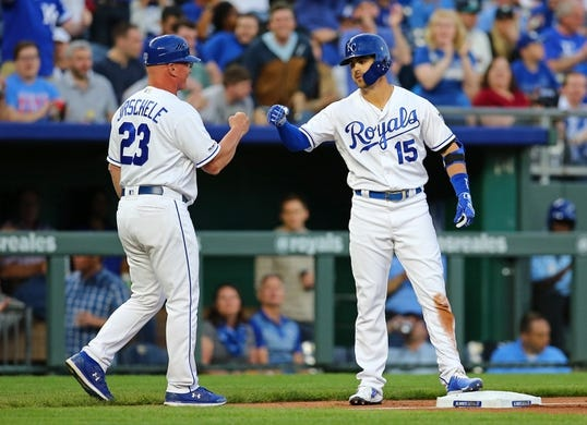 Apr 9, 2019; Kansas City, MO, USA; Kansas City Royals right fielder Whit Merrifield (15) is congratulated by third base coach Mike Jirschele (23) after hitting a triple against the Seattle Mariners in the first inning at Kauffman Stadium. Mandatory Credit: Jay Biggerstaff-USA TODAY Sports