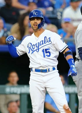 Apr 9, 2019; Kansas City, MO, USA; Kansas City Royals right fielder Whit Merrifield (15) celebrates after hitting a triple against the Seattle Mariners, extending his hitting streak to 30 consecutive games and tying George Brett for the Royals club record in the first inning at Kauffman Stadium. Mandatory Credit: Jay Biggerstaff-USA TODAY Sports
