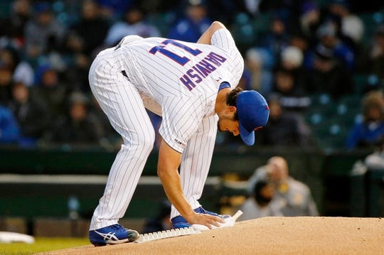 Apr 10, 2019; Chicago, IL, USA; Chicago Cubs starting pitcher Yu Darvish (11) uses the rosin bag between ptiches during the first inning against the Pittsburgh Pirates at Wrigley Field. Mandatory Credit: Jon Durr-USA TODAY Sports