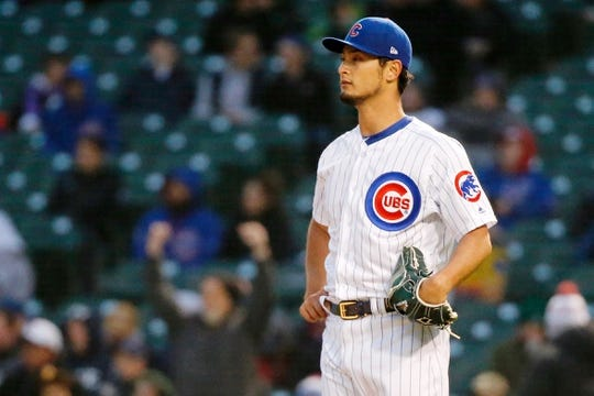 Apr 10, 2019; Chicago, IL, USA; Chicago Cubs starting pitcher Yu Darvish (11) reacts after giving up a home run to Pittsburgh Pirates catcher Francisco Cervelli (not pictured) during the first inning at Wrigley Field. Mandatory Credit: Jon Durr-USA TODAY Sports