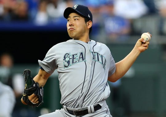 Apr 10, 2019; Kansas City, MO, USA; Seattle Mariners starting pitcher Yusei Kikuchi (18) throws the ball against the Kansas City Royals in the first inning at Kauffman Stadium. Mandatory Credit: Jay Biggerstaff-USA TODAY Sports