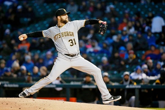 Apr 10, 2019; Chicago, IL, USA; Pittsburgh Pirates relief pitcher Jordan Lyles (31) pitches against the Chicago Cubs during the first inning at Wrigley Field. Mandatory Credit: Jon Durr-USA TODAY Sports