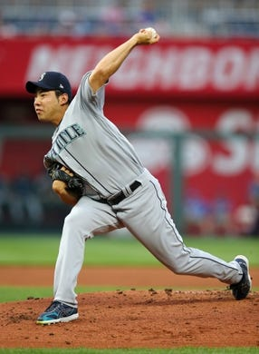 Apr 10, 2019; Kansas City, MO, USA; Seattle Mariners starting pitcher Yusei Kikuchi (18) warms up prior to the first inning against the Kansas City Royals at Kauffman Stadium. Mandatory Credit: Jay Biggerstaff-USA TODAY Sports
