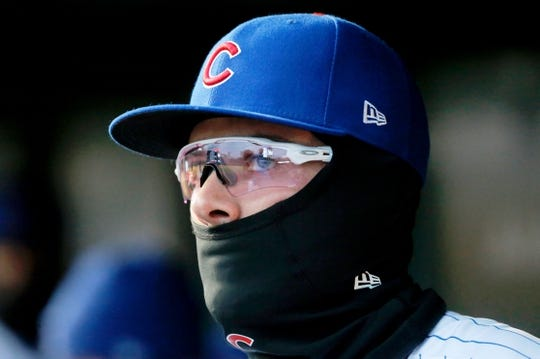 Apr 10, 2019; Chicago, IL, USA; Chicago Cubs third baseman Kris Bryant (17) prepares for the start of their game against the Pittsburgh Pirates while dressed for the cold at Wrigley Field. Mandatory Credit: Jon Durr-USA TODAY Sports