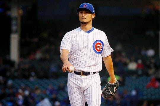 Apr 10, 2019; Chicago, IL, USA; Chicago Cubs starting pitcher Yu Darvish (11) reacts at the end of the first inning against the Pittsburgh Pirates at Wrigley Field. Mandatory Credit: Jon Durr-USA TODAY Sports
