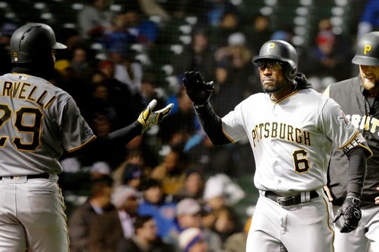 Apr 10, 2019; Chicago, IL, USA; Pittsburgh Pirates center fielder Starling Marte (6) is congratulated by catcher Francisco Cervelli (29) after hitting a home run against the Chicago Cubs during the third inning at Wrigley Field. Mandatory Credit: Jon Durr-USA TODAY Sports