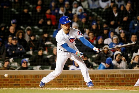 Apr 10, 2019; Chicago, IL, USA; Chicago Cubs starting pitcher Yu Darvish (11) swings and misses during his at bat against the Pittsburgh Pirates during the third inning at Wrigley Field. Mandatory Credit: Jon Durr-USA TODAY Sports